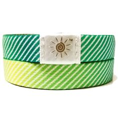Green/Yellow Stripe Wrist Band - Stretches to fit snug on the wrist! Get one today at www.brightbands.com
