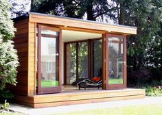 modern tiny house with lots of windows