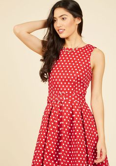 It's time to put those swing lessons to the test, and there's no better frock for the job than this red dress! Livening up your dance marathon routine with its white polka dots, belted waist, and pleated skirt, this vintage-inspired number keeps you moving with endless finesse.