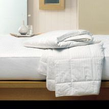 Our cotton quilt, mattress protector and pillow protector will help you create a total bedroom package that offers year round comfort and is perfect for the warmer months. Cotton is easy to care for and because it is a natural fibre, it breathes and helps you regulate your body temperature as you sleep.The cotton quilt features box pleating which holds the 250 gsm luxury cotton fill in place and the mattress protector has a fully fitted 35 cm skirt. Both the mattress protector and pillow…