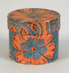 Small Pennsylvania wallpaper box, mid 19th c., having orange floral decoration on a blue ground, 3'' h., 3 3/4'' dia.