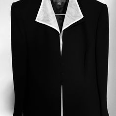 Liz Claiborne Chic black suit Gorgeous Black suite with white sheer underlay in jacket with 3 button closure. Jacket hits about mid thigh and pants are fully lined. It looks amazing on I love it , but to large for me. Sold as a set. Liz Claiborne Jackets & Coats