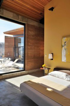 An architect and an interior designer bring rammed earth to Wyoming.