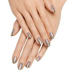 midas touch by essie - dipped-in-gold manicured tips are the perfect accessory for a holiday party dress.