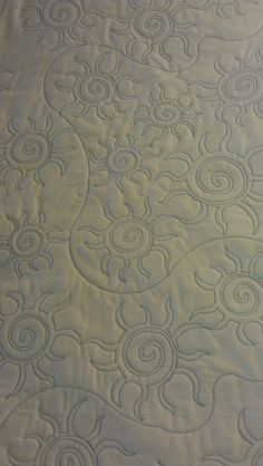 """This is a great quilt pattern called SW Sun and it works very well on quilts that have desert or southwest colors.  I've even use it on quilts that are """"organic"""" in colors."""