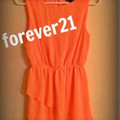 Coral Dress from forever 21 Very cute coral dress with ruffle bottom and keyhole in back! Its a size medium! Forever 21 Dresses