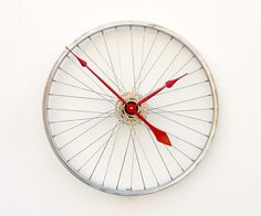 Recycled Bike Wheel clock. I can think of a lot of bike shops and cyclists who need this :)