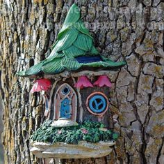 Fairy Homes and Gardens - Solar Fairy Door with Pink Flower Lights, $24.99 (https://www.fairyhomesandgardens.com/solar-fairy-door-with-pink-flower-lights/)