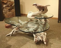 "PAUL A. BALIKER is an artist who creates sculptural furniture from wood. This piece is the ""Osprey Table"" / Sculpture by Paul Baliker"