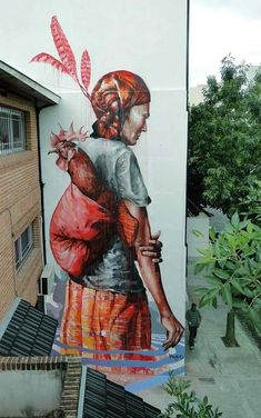 His pieces are HUGE: The Displaced, Buenos Aires, Argentina. | 27 Jaw Dropping Works Of Street Art So Big They Will Never Fit In A Gallery