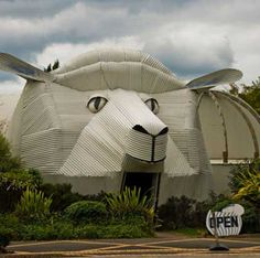 This is the Big Sheep Wool Gallery in Tirau, New Zealand.  Made of corrugated iron, Inside you'll find all kinds of NZ knitwear and luxurious wools.