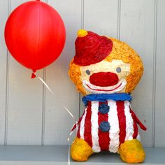 The goal here was to make a clown that no one could be afraid of, and I think weve achieved that.  This cute circus clown piñata would make a great balloon anchor for your next circus or carnival themed party.24 inches tall*balloon is a photo propAll pieces are handcrafted in southern California upon order and take between 2-3 weeks to process. Rush orders may be available if our schedule permits so feel free to contact us if youre interested.Well add up to 20 pull...