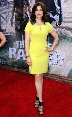 Bellamy Young was a bright sight on the 'Lone Ranger' red carpet in a yellow dress with a keyhole neckline.