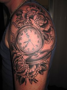 Pocket Watch Tattoo... definitely would consider it in a much smaller size and without the ribbon of pearls