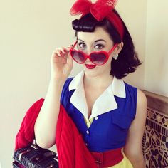 Pin for Later: 23 Ways to Channel Snow White This Halloween 1950s Snow White Betty bangs, bright red lips, and perfectly manicured nails are a must.