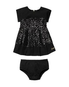 Sequin lace dress and diaper cover for a baby girl.