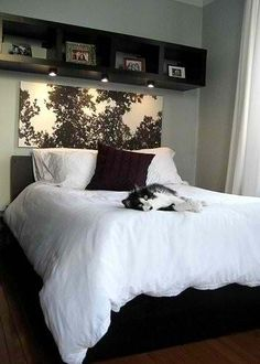 Love the picture behind the bed to tie in the black and white theme