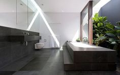beautiful sunlit bathroom - Flipped House by MCK Architects