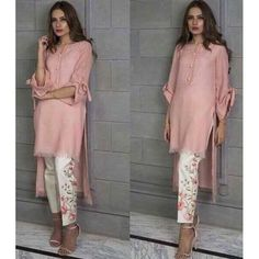 Beautiful & stylish plain silk shirt with embroidered pants. Color of shirt can be changed. And it should be mentioned in notes during checkout. Available in all sizes in all colors. Available with white embroidered pants. Pakistani Dress Design, Pakistani Outfits, Indian Outfits, Kurta Designs, Blouse Designs, Trajes Pakistani, Stylish Dresses, Casual Dresses, Pakistan Fashion