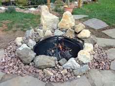 Backyard fire pit made from FREE stones found on the roadside. Bring them home, then go to Home Depot and buy a $50.00 metal fire pit insert with a screen top. Build a stone design around your pit that will enhance your back yard and cement the stones in place. No need for the legs... BOOM! Your done in one afternoon.