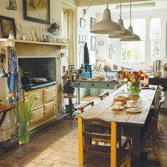 Who's cooking up a storm in the kitchen? We love how this homeowner has opted for freestanding vintage furniture over fitted cabinetry, it gives such a quirky, homely feel  Richard Parsons - - - - - - #periodliving #periodhome #interiors #oldhome #decorating #unfittedkitchen #freestandingkitchen #aga #rangecooker #farmhousekitchen #kitcheninspo #homeinspo #decorinspo #vintagefurniture #reclaimed #salvage #industrialpendants #pendantlamps