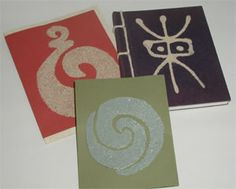 Sand cards. Draw a traditional design onto card and fill with glue (or use a double sided adhesive paper you can cut the design out of), then cover with sand. http://www.craftsforkids.com/projects/900/904_4_1.htm