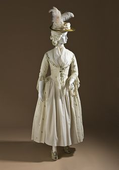 Robe a l'Anglaise, British, 1780-90. Cotton plain-weave with wool embroidery.