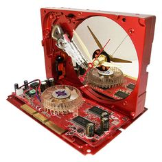 Metallic Red Hard Drive Clock, Rare Red Graphics Circuit Board as the Base.. $48.00, via Etsy. Awesome Gift for the Geek.