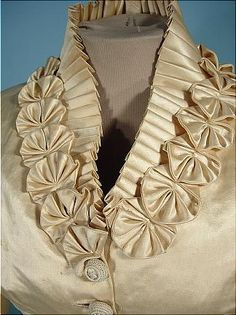 Pleats and elaborate hand-sewn trim, probably 1870s-80s bustle bodice.