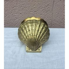 Add a vintage nautical vibe to your bookshelf with these brass shell bookends.