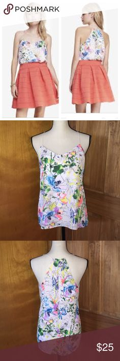 "⚡️SALE Express Barcelona Cami Watercolor Tank Sml Beautiful floral watercolor reversible Cami. Size small from Express Barcelona line. Can be worn two ways. As a Halter or v neck. Size small. 17"" bust. Length front is 25"" Back is 27.5"". Love these! I have about 20 but had to downsize to extra small. So I will be listing a ton of them. I wear them alone or under Blazers! I love bundling and offers and ship fast! Express Tops Tank Tops"