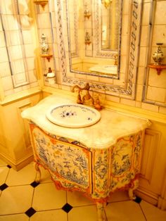 Painted antique commode turned into sink/vanity