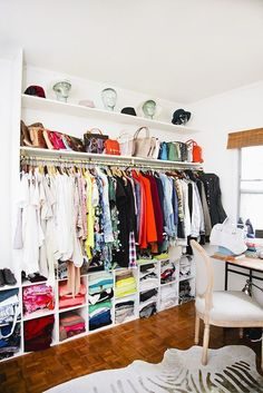 Using a wall of a room setup as a closet. Love this idea!
