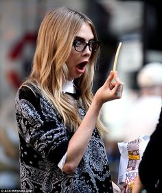 Cara Delevingne chows down on a McDonald's meal in between takes on her DKNY shoot  Read more at ONTD: http://ohnotheydidnt.livejournal.com/82487952.html#ixzz2iNWREL6y