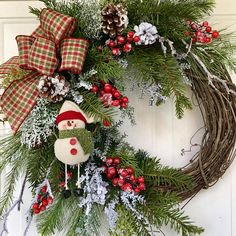 A whimsical winter wreath full of holiday cheer will bring a smile to all who pass by. This is the perfect wreath to tuck into a little spot in your home needing some Christmas merriment. Realistic faux evergreen boughs, cedar, snowy branches, an abundance of snow covered pine cones,