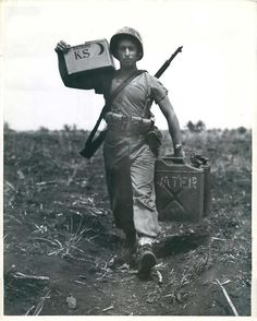 WWII U.S. Marine Carrying Rations & Water to Front Lines on Saipan Press Photo
