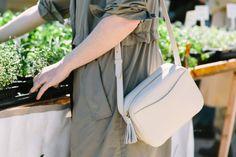 Cuyana leather mini tassel bag