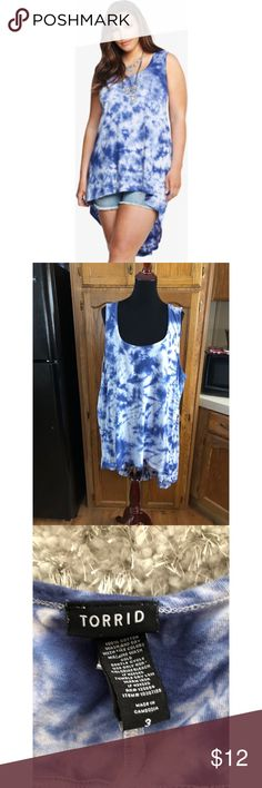 Torrid Tie Dyed High Low Top Size 3 (3X) High low style tank top. Blue and white tie dyed.  From Torrid.  Size 3 (3X).  Good condition.  Important:   All items are freshly laundered as applicable prior to shipping (new items and shoes excluded).  Not all my items are from pet/smoke free homes.  Price is reduced to reflect this!   Thank you for looking! torrid Tops Tank Tops