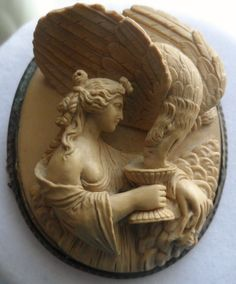 Lava Cameo of Hebe feeding Zeus in the form of a eagle