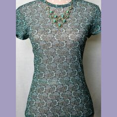 LIMITED Stretch Paisley Shirt Form fitting Aqua blue and Teal print. Size L. Semi sheer. 100% Nylon. Great condition. Accessories shown are sold separately. The Limited Tops Tees - Short Sleeve