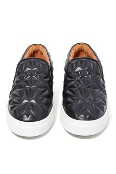 All hail the slip-on sneakers that require the least amount of effort and pay off with a crazy amount of chic—AKA the lazy-girl shoe.  Sarlo 3D Leather Slip-On, $165 ; Nastygal.com   - MarieClaire.com