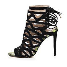 0e4bcdfb71c39 Chaussures à talons aiguilles en cuir noir à lacets effet cage - Chaussures  à lacets effet cage - Chaussures bottes - femme