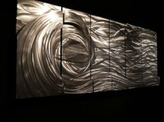Modern Wall Art. Handsanded finish with contemporary metal wall decor! by ASH CARL, http://www.amazon.com/dp/B001ND6INQ/ref=cm_sw_r_pi_dp_ArmHqb1Q7551P