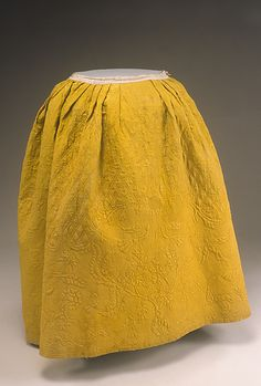 textile: English; garment: American  petticoat  circa 1750  Clothing  textile: yellow plain weave silk (taffeta); green plain weave wool; batting  HD F.122 (Historic Deerfield)  Mrs. Helen Geier Flynt