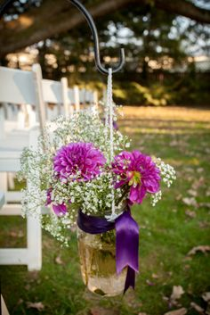 Mason jars overflow with purple dahlias and baby's breath at Nicole and Mark's Aldie Mansion wedding - by Buttercup: Photography by Jung Wi Allure West Studios.