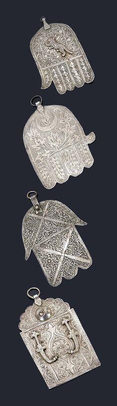 Four silver hamsa pendants !