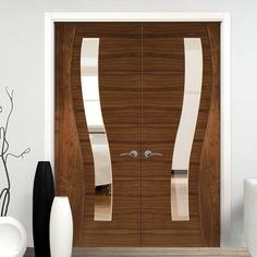 Contemporary Design Cadiz Walnut Prefinished Door Pair with Clear safety Glass. #moderndoors #contemporarydoors #walnutdoors
