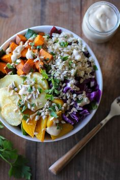 Roasted Root Vegetable Buddha Bowls with Maple Cinnamon Tahini Dressing...a.k.a. this blog's signature Buddha Bowl. Let's talk about the Super Bowl. Namely, this Super Buddha Bowl o' Root Vegetable...
