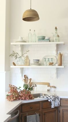 4 Inexpensive Ways to Update A Tired Ktichen. Open shelving and subway tile in a modern farmhouse inspired kitchen