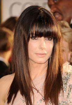 Pretty, dark straight hair with bangs